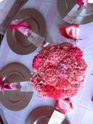 Pretty, Soft, Full Centerpiece with Carnations in Different Shades of Pink