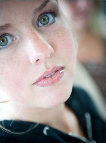 Closeup of beautiful bride with wedding day makeup, green eyes pop, natural lip