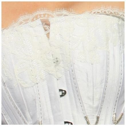 Beautiful white lace corset with silver clasps