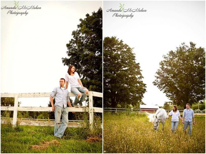 Happy couple pose outside their barn in green field, white fence, stunning white horse