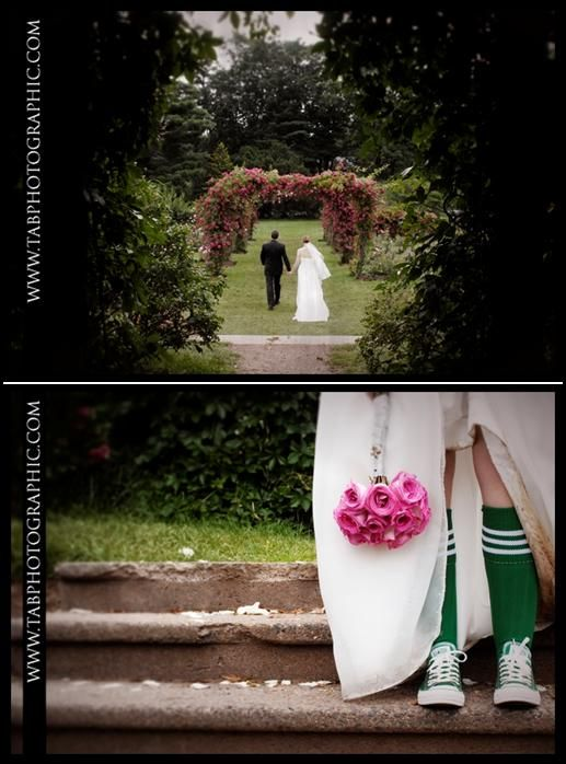 Bride and groom walk hand in hand through beautiful fuschia rose arch; sporty bride in green convers