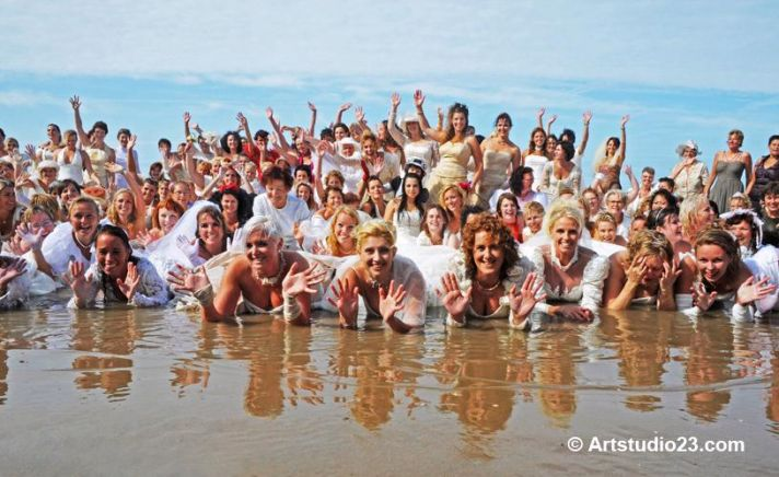 99 Dutch brides trash the dress in the Northsea, Netherlands