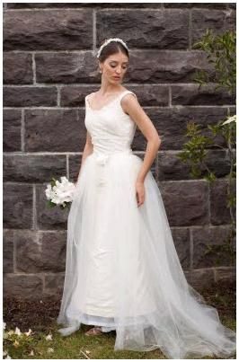 Conservative white wedding dress with hook-on and off tulle overskirt