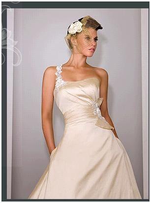 Stunning ivory one-shoulder wedding dress by Martina Liana