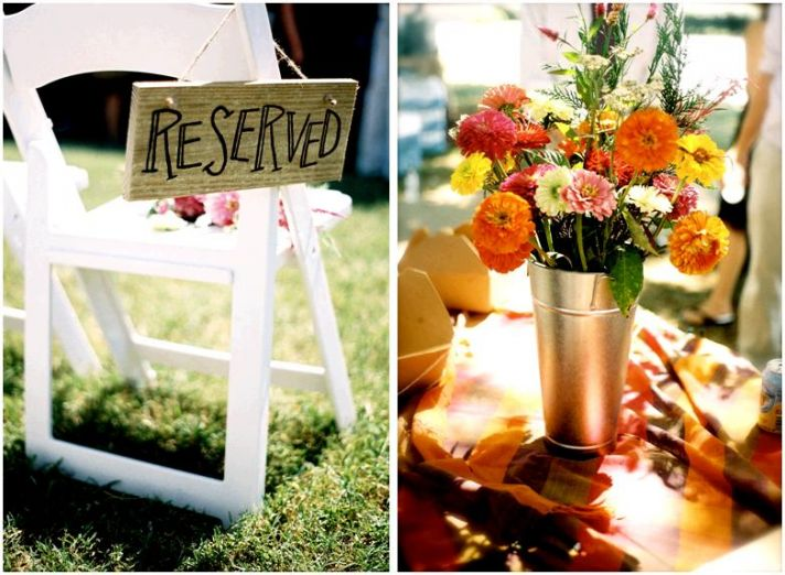 "Handmade ""Reserved"" sign made of wood; vibrant orange, yellow and pink floral centerpiece"
