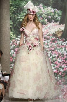 Whimsical ivory wedding dress with muted pink and green floral print, perfect for a garden wedding
