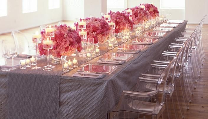 Stunning wedding reception tablescape with pink, fuschia, rose and peach floral centerpieces, pewter