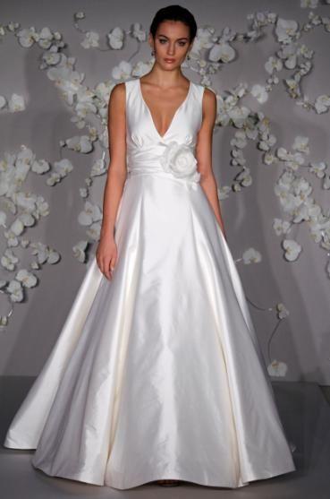 Ivory tissue taffeta wedding dress with deep v neckline, princess skirt, and flower applique at natu