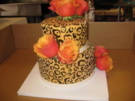 This two tired leopard print wedding cake with roses is an unusual choice for a wedding.