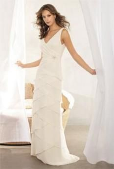 This casual wedding dress has a deep cut v neck and is sleveless.