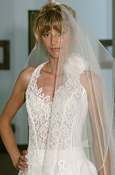 White semi-sheer wedding dress corset with floral lace design and pointed halter neckline