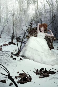 Romantic white wedding dress with tiered skirt, perfect for winter wedding