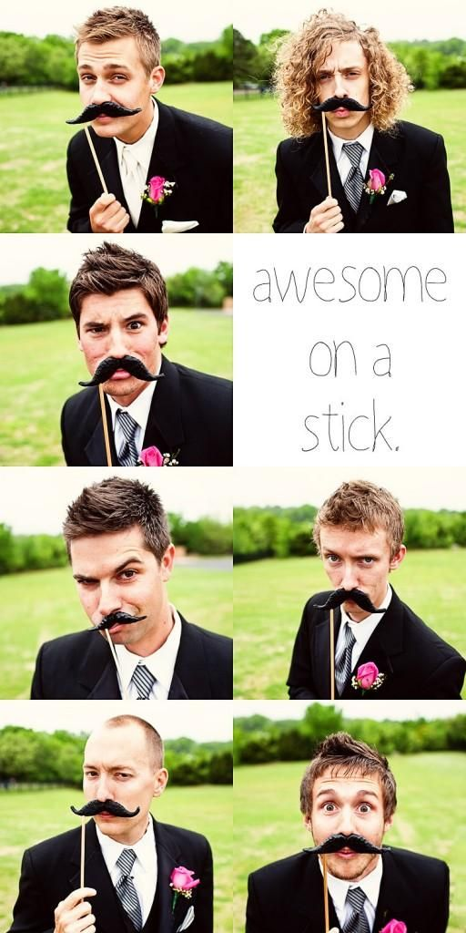 Young fun groomsmen pose with mustaches on a stick- makes for memorable wedding photos!