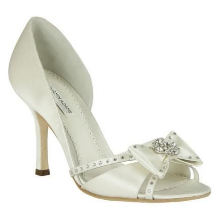 Adorable white open toe bridal heels with cute bow and Swarovski details