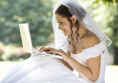 This bride in her white dress and veil may have waited a little too long to use the computer to plan