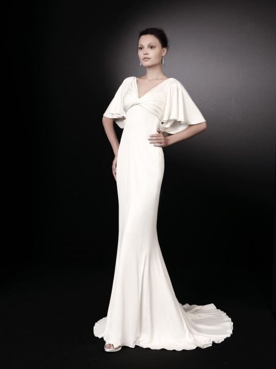 Chic v-neck white wedding dress by Peter Langner with flirty sleeves