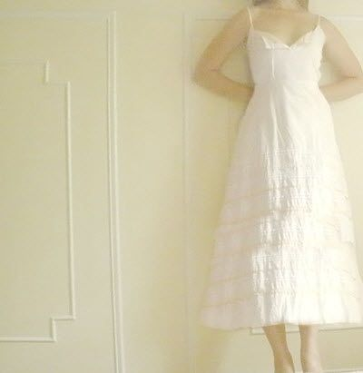 Casually beautiful, this white tea length wedding dress is perfect for a low-key beach or picnic wed