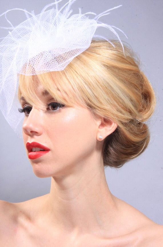 Beautiful vintage-inspired bridal hairstyle with white birdcage veil