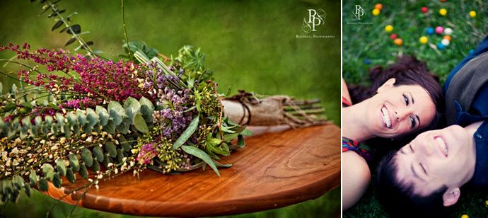 Stunning floral arrangement for engagement session; bride and groom lay on grass, surrounded by gumb