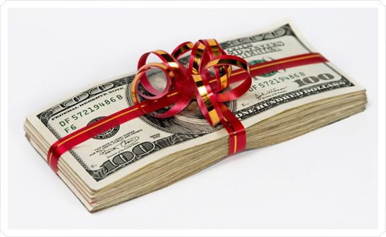 This pile of cash wrapped in red and gold ribbons symbolizes giving a tip to a vendor on your weddin