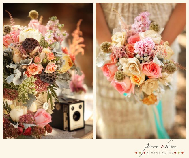 Beautiful colorful floral centerpiece and bridal bouquet with aqua ribbon