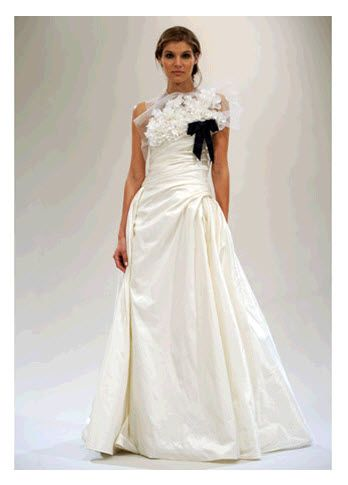 Sophisticated Parisian-Chic Reem Acra wedding dress with high neckline and black bow
