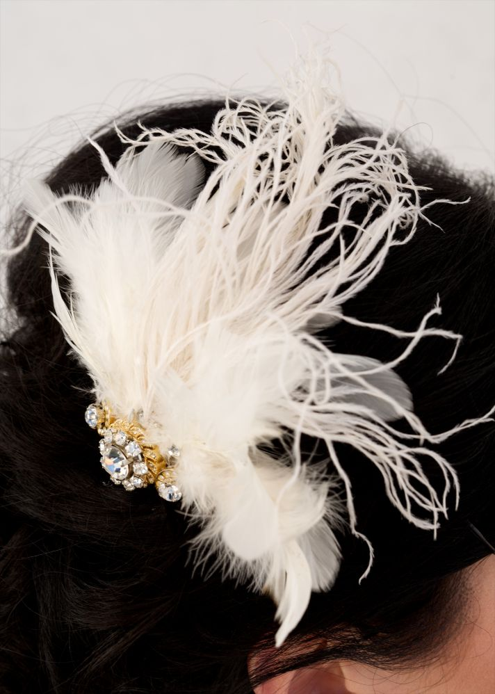 Stunning refashioned bridal hair accessory made from feathers, Swarovski crystals, and an old gold w