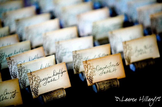 Antique looking escort cards sit in individual wine corks