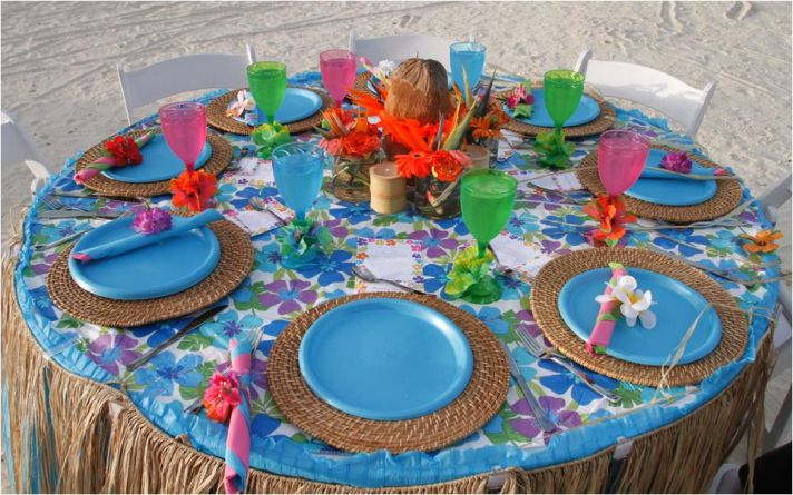 Blue, serene luau-themed rehearsal dinner tablescape