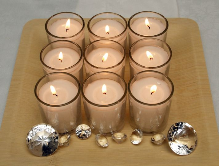 The easiest DIY wedding reception decor idea around- place votives and faux diamonds on a square tra
