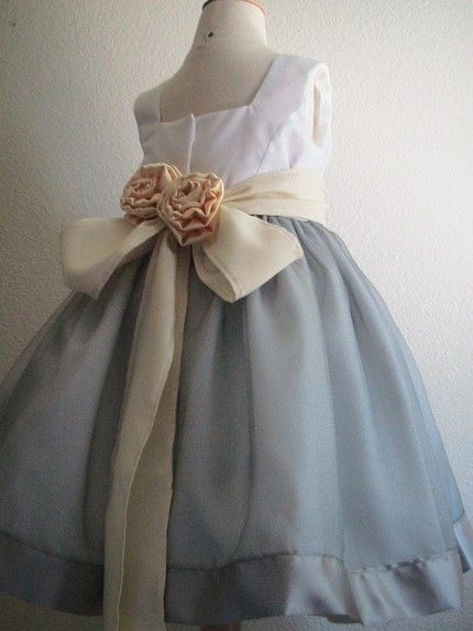 Vintage-inspired flower girl dress with full ice blue skirt and champagne-colored sash