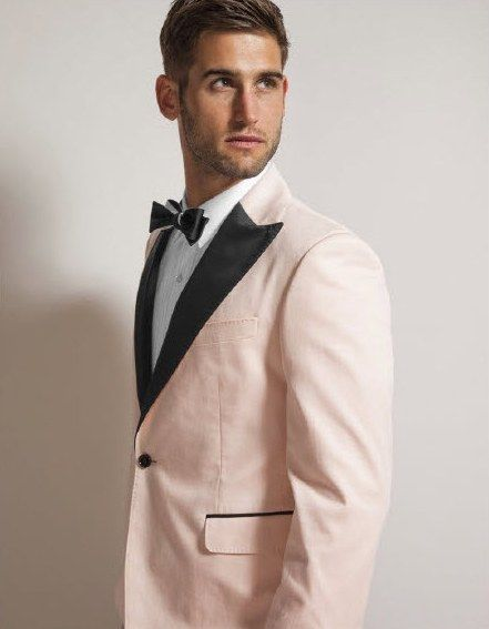 Quirky stylish wedding day look for the Groom a light pink tux jacket with