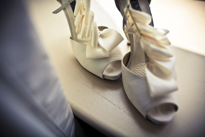One last shot of the bride's ivory peep-toe bridal heels with ruffle details