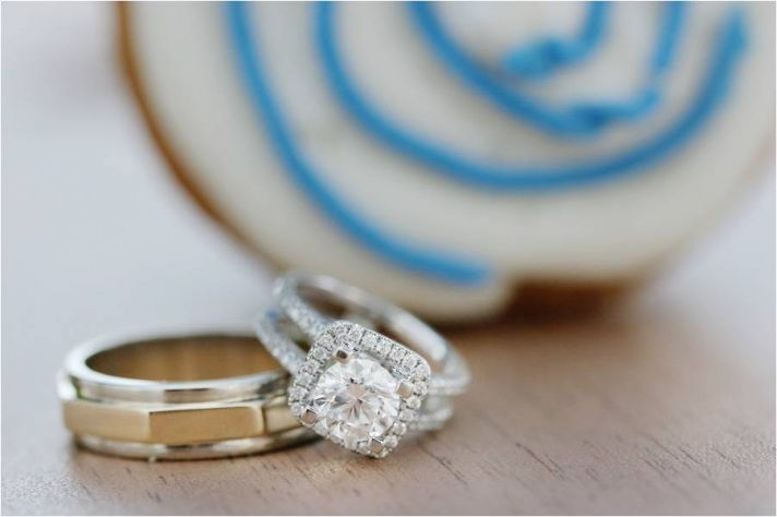 Stunning cushion cut diamond engagement ring, groom's platinum and gold wedding band, with blue and