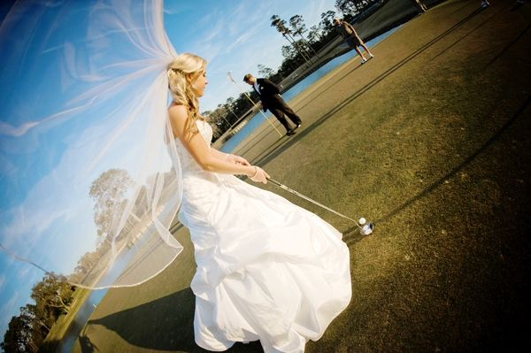 Bride wears white classic a-line wedding dress and tulle veil, puts on the golf course