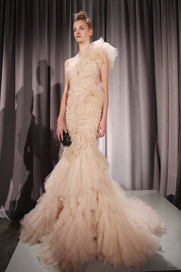 This pink Marchesa wedding dress is definitely high fashion.