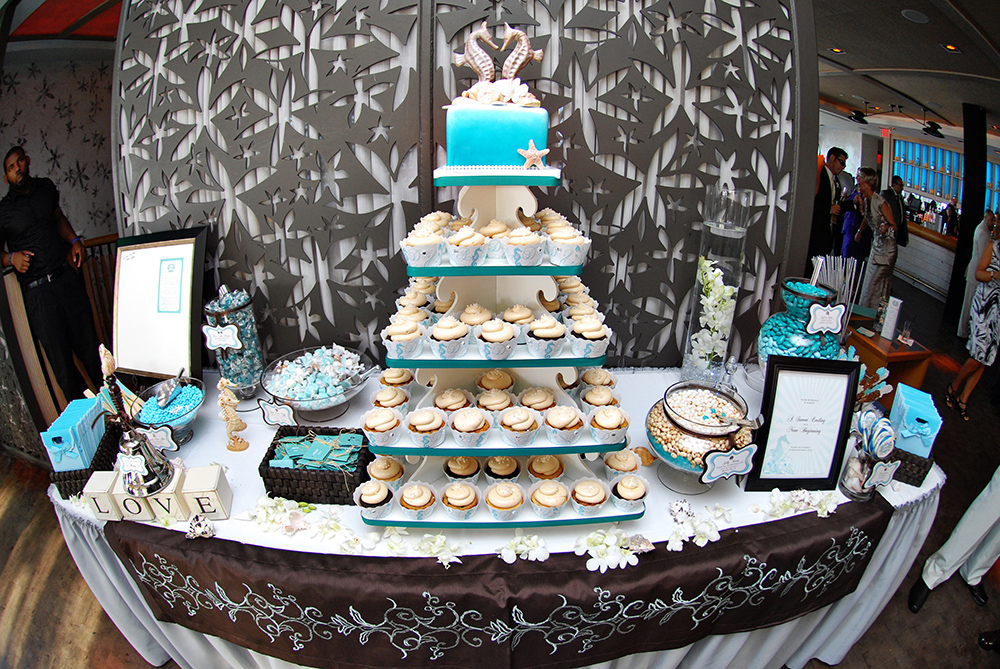 Long Branch wedding reception beachthemed dessert table with cupcake tree