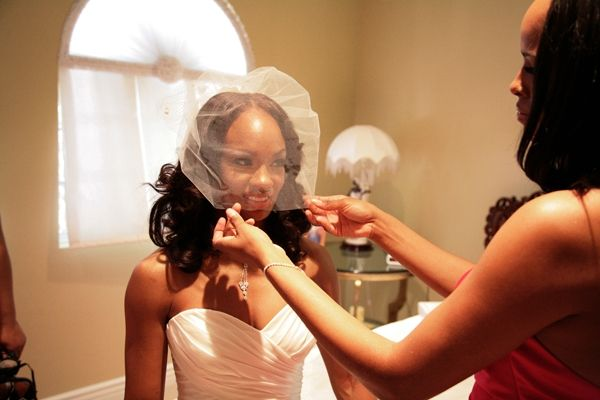 Bride wears sweetheart neckline Watters wedding dress & pouf veil