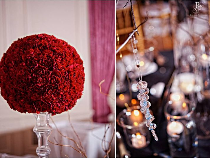 High wedding reception topiary with dome of clustered red carnations