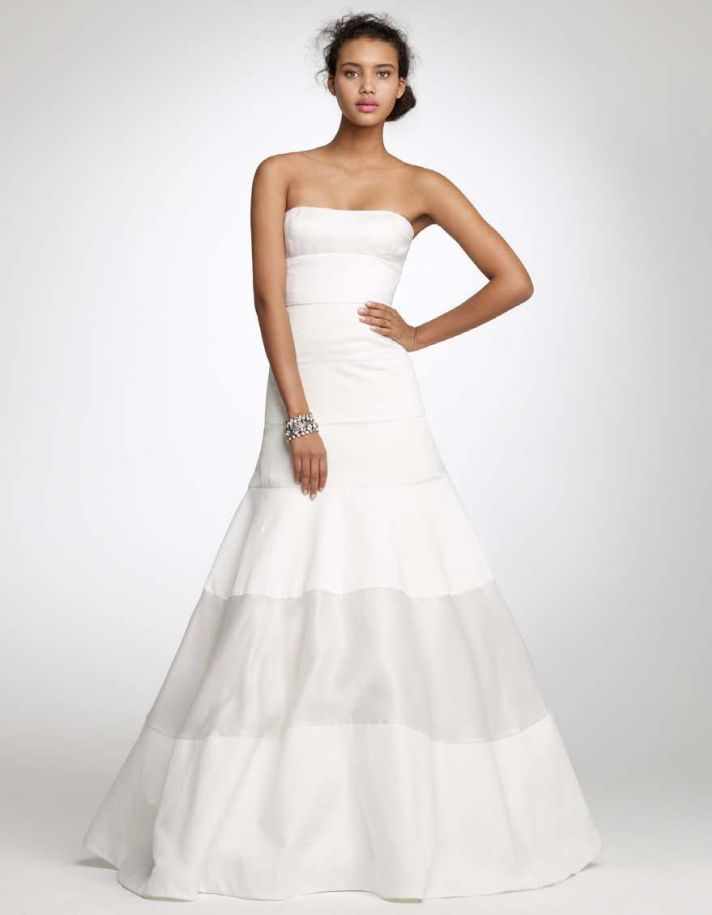 White strapless full a-line J.Crew wedding dress with silver fabric band on skirt