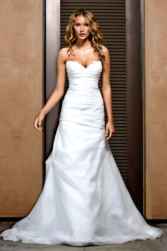White Italian lace sweetheart neckline wedding dress by Jenny Lee