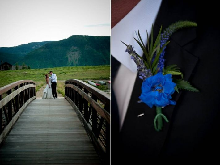Bride and groom kiss after saying I Do with Colorado mountains in background