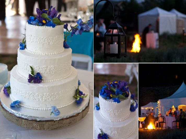 Classic white three tier wedding cake adorned with fresh deep purple flowers