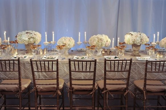 Sophisticated elegance returns for 2011 weddings- long tablescape with muted metallic color palette