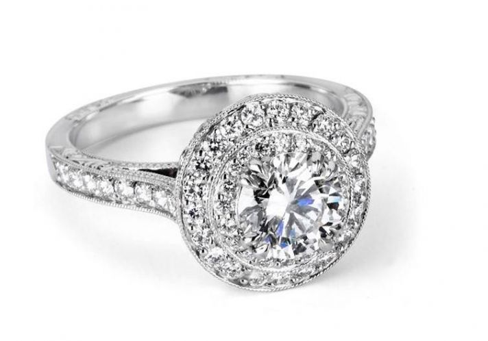 Diamond engagement ring with pave channel set platinum setting