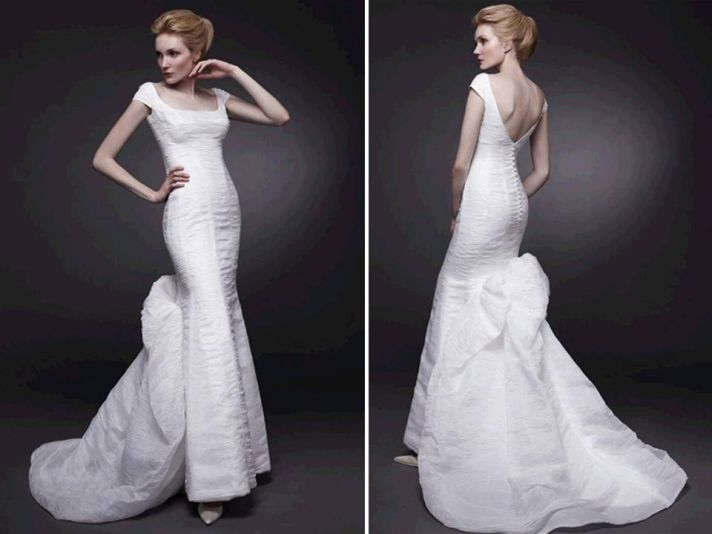 Timeless white mermaid wedding dress with scoop neck and detail on skirt