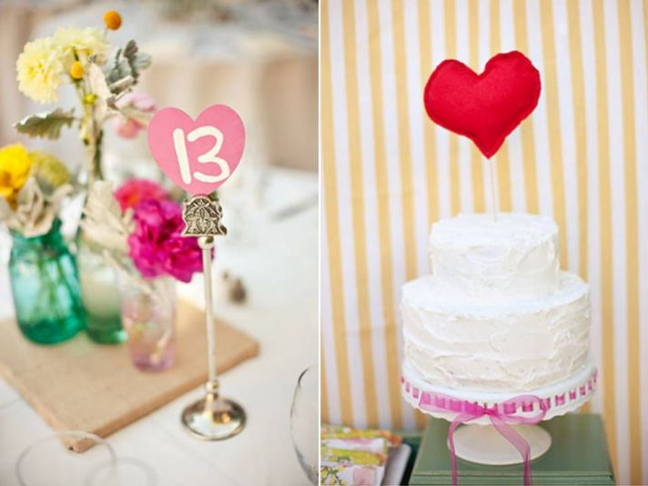 Adorable white wedding cake with red heart cake topper