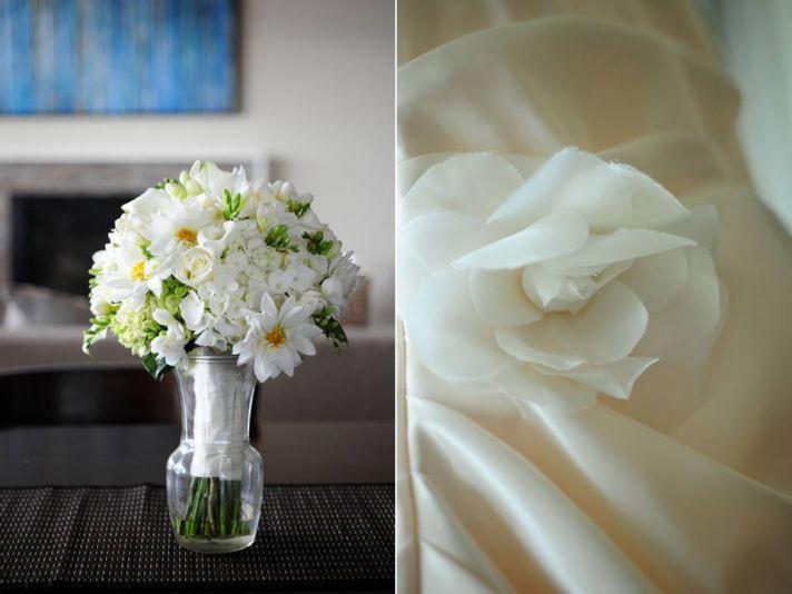 Ivory daisy bridal bouquet and classic ivory wedding dress