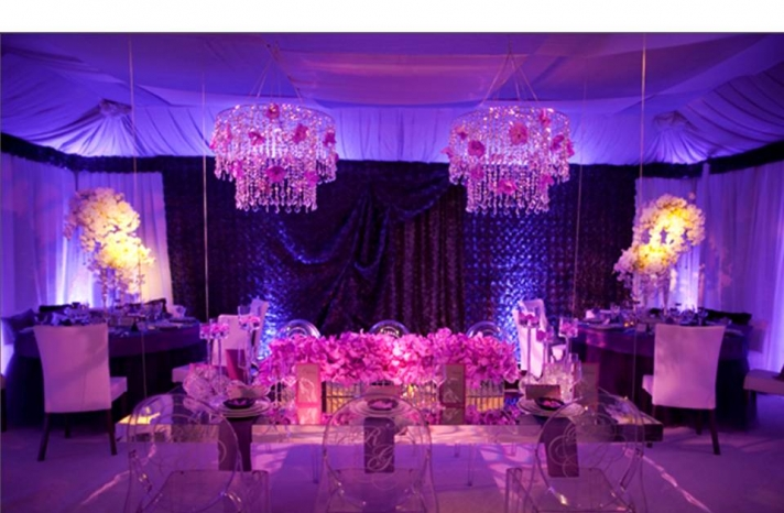 glam-wedding-reception-room-ghost-chairs-chandelier-purple-orchids