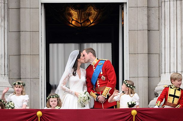 Kate Middleton and Prince William engaging in the much-anticipated balcony kiss